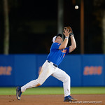 University of Florida Gators infielder Deacon Liput catching a flyball as the University of Florida Gators defeat the Wake Forest Demon Deacons 3-0 during Game 3 of the 2017 NCAA Super Regionals at McKethan Stadium.  June 12th, 2017. Gator Country photo by David Bowie.