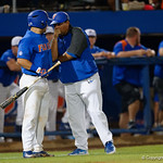 University of Florida Gators baseball assistant coach Craig Bell talks with University of Florida Gators catcher Mike Rivera before Rivera goes to the plate, as the University of Florida Gators defeat the Wake Forest Demon Deacons 3-0 during Game 3 of the 2017 NCAA Super Regionals at McKethan Stadium.  June 12th, 2017. Gator Country photo by David Bowie.