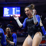 University of Florida Gators gymnast Amelia Hundley congratulates fellow gymnast Rachel Slocum after her 9.975 vault routine as the Gators defeat the University of Georgia Bulldogs at the Stephen C. O'Connell Center.  February 10th, 2016. Gator Country photo by David Bowie.