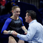 University of Florida Gators gymnast Rachel Gowey getting coached up by Gators assistant coach Adrian Burde as the Gators defeat the University of Georgia Bulldogs at the Stephen C. O'Connell Center.  February 10th, 2016. Gator Country photo by David Bowie.