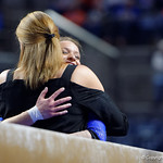 University of Florida Gators gymnast Amanda Cheney gets a hug from head coach Jenny Rowland after performing on the beam as the Gators defeat the University of Georgia Bulldogs at the Stephen C. O'Connell Center.  February 10th, 2016. Gator Country photo by David Bowie.