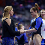 University of Florida Gators gymnast Grace McLaughlin getting coached up by head coach Jenny Rowland after performing on the beam as the Gators defeat the University of Georgia Bulldogs at the Stephen C. O'Connell Center.  February 10th, 2016. Gator Country photo by David Bowie.
