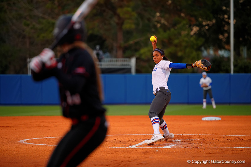 Florida Gators pitcher Aleshia Ocasio throws toward home plate during the first inning.  Florida Gators vs NC State Wolfpack.  February 13th, 2015. Gator Country photo by David Bowie.