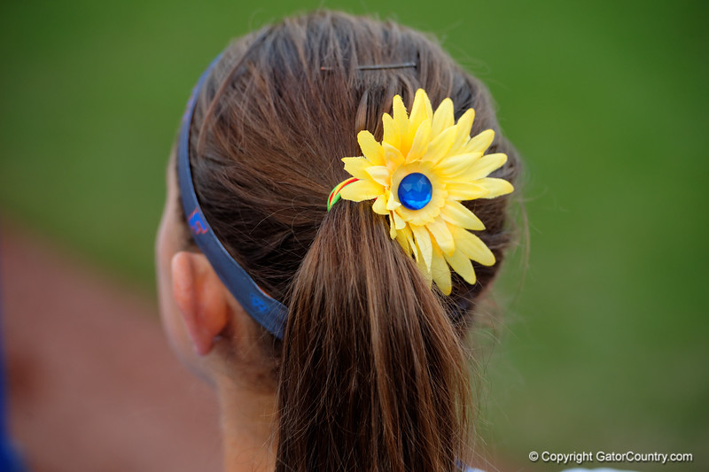 The Florida Gators wore yellow flowers to honor Heather Braswell.   Florida Gators vs NC State Wolfpack.  February 13th, 2015. Gator Country photo by David Bowie.