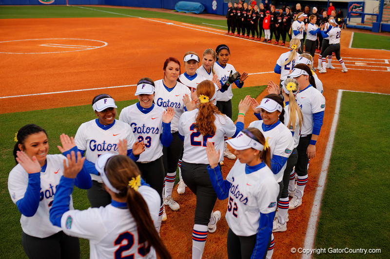 The Florida Gators take the field for the start of the game.  Florida Gators vs NC State Wolfpack.  February 13th, 2015. Gator Country photo by David Bowie.