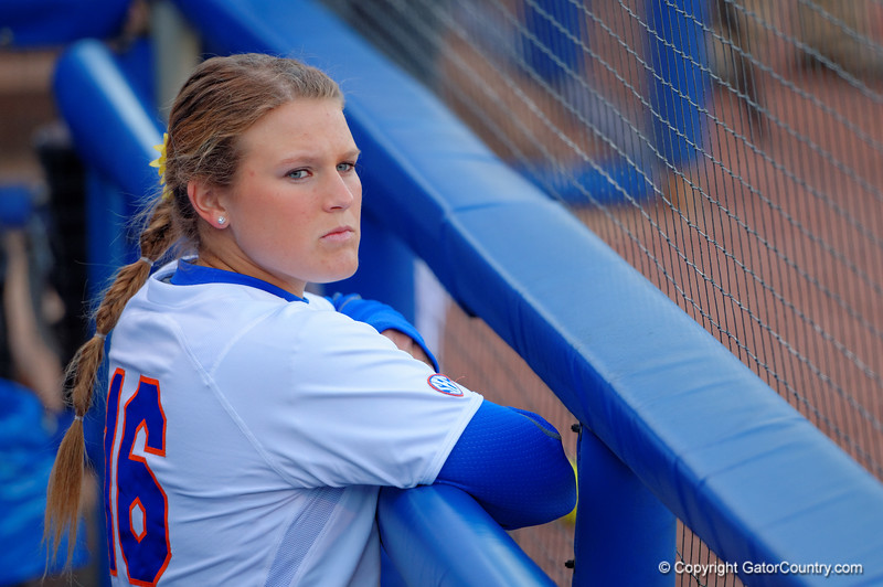 Florida Gators UT Becca Shipper waits in the dugout for the game to start.  Florida Gators vs NC State Wolfpack.  February 13th, 2015. Gator Country photo by David Bowie.