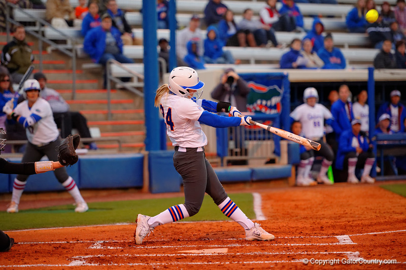 Florida Gators outfielder Kirsti Merritt drives the ball deep but foul during the first inning.  Florida Gators vs NC State Wolfpack.  February 13th, 2015. Gator Country photo by David Bowie.