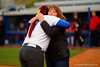 Florida Gators RHP/1B Lauren Haeger hugs the mother of Heather Braswell after she threw out the first pitch.  Florida Gators vs NC State Wolfpack.  February 13th, 2015. Gator Country photo by David Bowie.