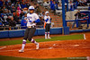 Florida Gators second baseman Kelsey Stewart comes in to score and give the Gators a 1-0 lead in the first inning.  Florida Gators vs NC State Wolfpack.  February 13th, 2015. Gator Country photo by David Bowie.