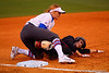 Florida Gators third baseman Taylore Fuller tags out a NC State player sliding into third.  Florida Gators vs NC State Wolfpack.  February 13th, 2015. Gator Country photo by David Bowie.