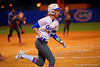 Florida Gators catcher Aubree Munro grounds out a ball to end the second inning.  Florida Gators vs NC State Wolfpack.  February 13th, 2015. Gator Country photo by David Bowie.