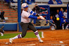Florida Gators RHP/1B Lauren Haeger drives the ball for a base hit in the first inning.  Florida Gators vs NC State Wolfpack.  February 13th, 2015. Gator Country photo by David Bowie.
