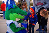 Alberta shares candy with kids for Valentines Day.  Florida Gators vs NC State Wolfpack.  February 13th, 2015. Gator Country photo by David Bowie.