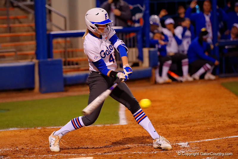 Florida Gators first baseman Taylor Schwarz swings at a pitch during the second inning.  Florida Gators vs NC State Wolfpack.  February 13th, 2015. Gator Country photo by David Bowie.