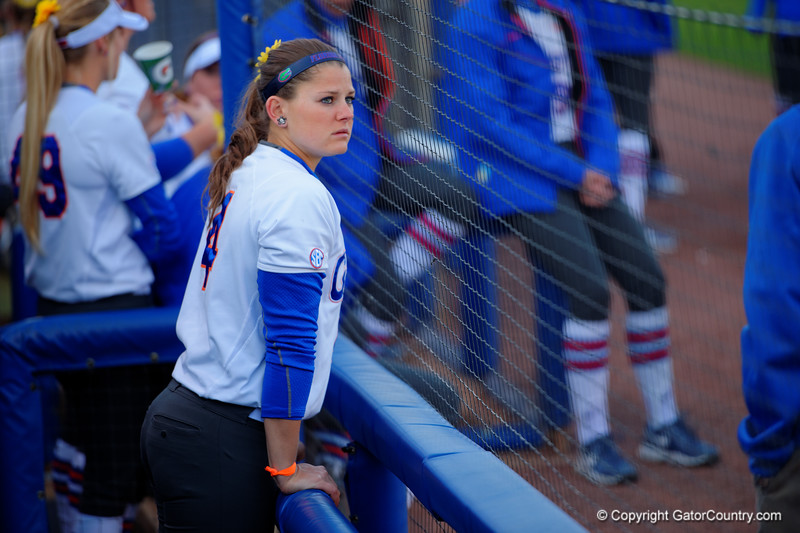 Florida Gators outfielder Jessica Damico waits in the dugout for the game to start.  Florida Gators vs NC State Wolfpack.  February 13th, 2015. Gator Country photo by David Bowie.