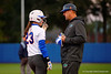 Florida Gators assistant coach Kenny Gajewski talks with Florida Gators infielder Nicole DeWitt at first base.  Florida Gators vs NC State Wolfpack.  February 13th, 2015. Gator Country photo by David Bowie.