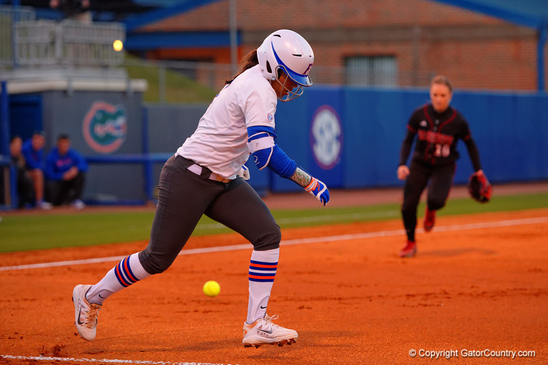 Florida Gators second baseman Kelsey Stewart sprints toward first base after making contact.  Florida Gators vs NC State Wolfpack.  February 13th, 2015. Gator Country photo by David Bowie.