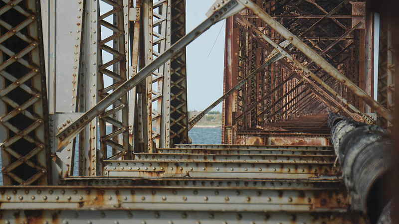 Girders of old bridge with pipe