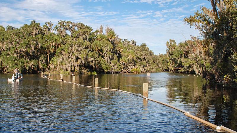 Floating barrier in river
