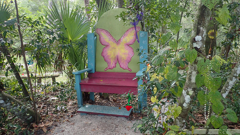 Big chair with butterfly painted on it