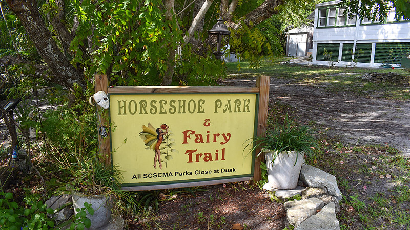 Horseshoe Park sign next to historic home