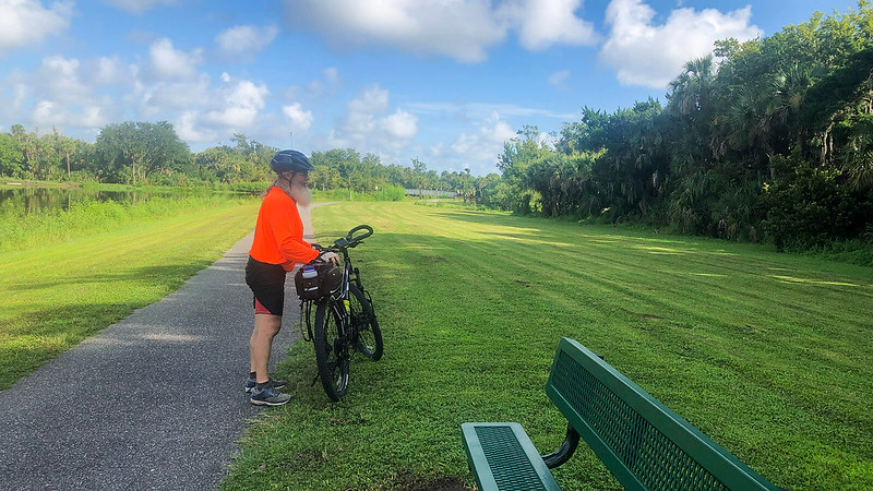 John and his bicycle along trail