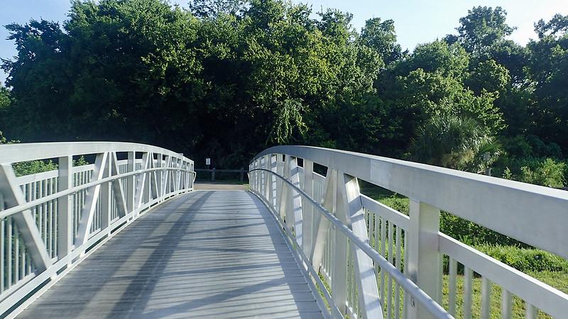 Bridge for paved path