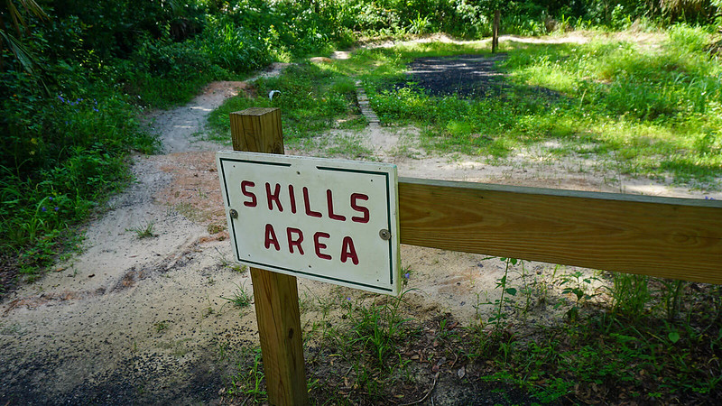 Skills area sign and narrow boardwalk