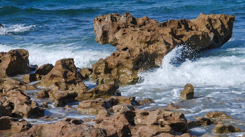 Rugged rocks splashed by waves