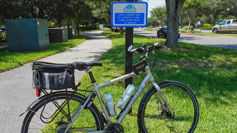 Bike next to trail junction sign