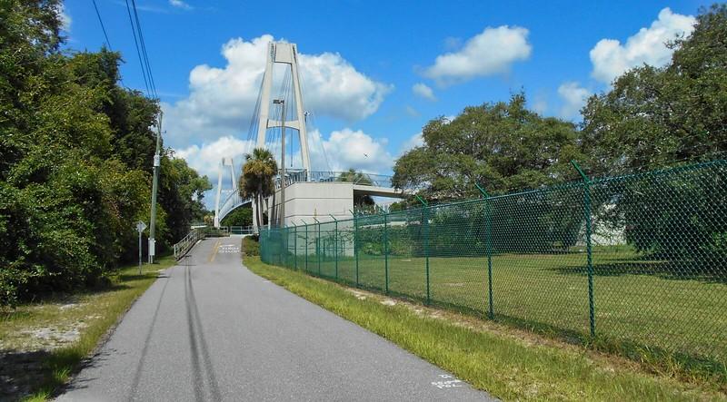 Bike path leading to large bridge
