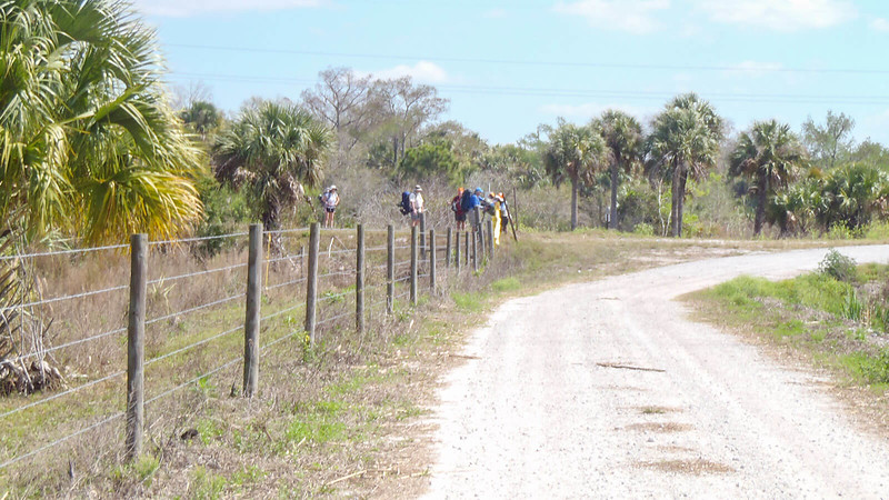 Hikers crossing a gate