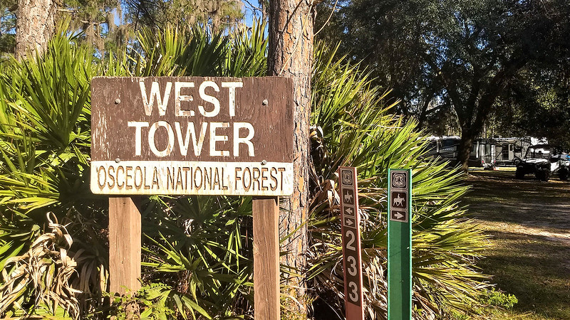 Sign for West Tower and campers beyond