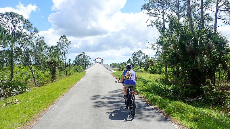 Sandra biking to bridge over interstate
