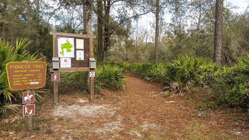 Trailhead with mileage sign and map kiosk