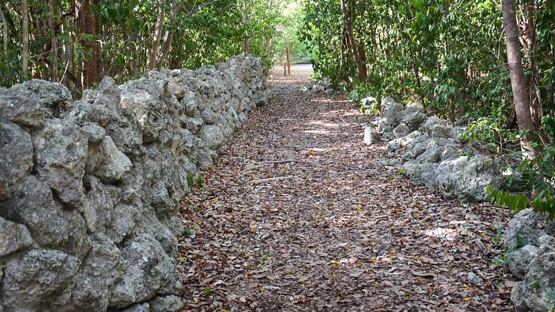 Trail along rock wall