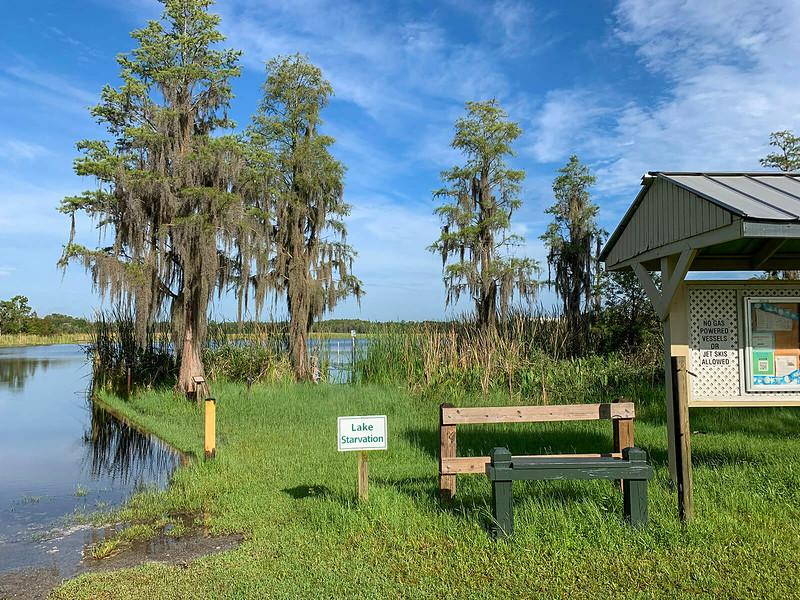 Kayak launch at kiosk adjoining marshy edge of lake