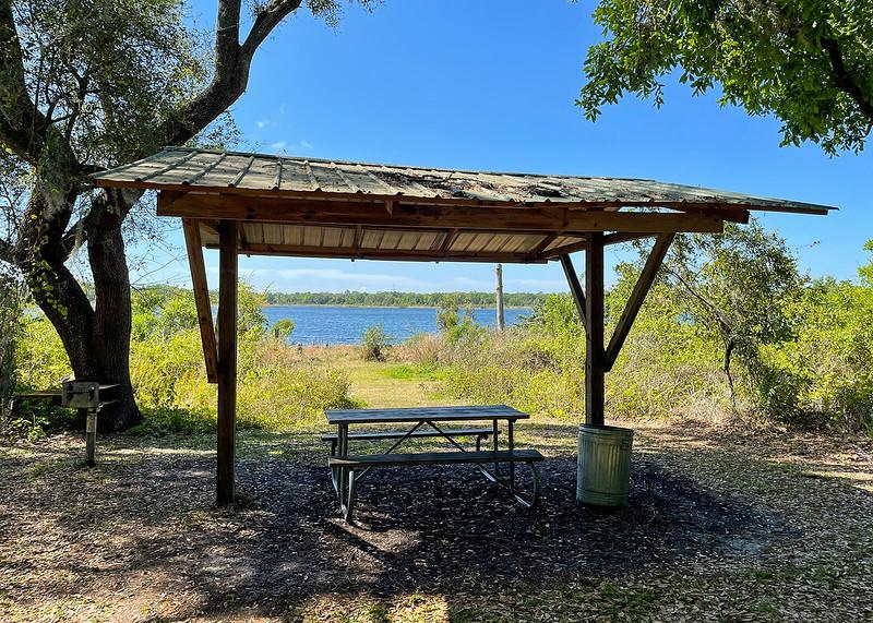 Picnic bench along a lake
