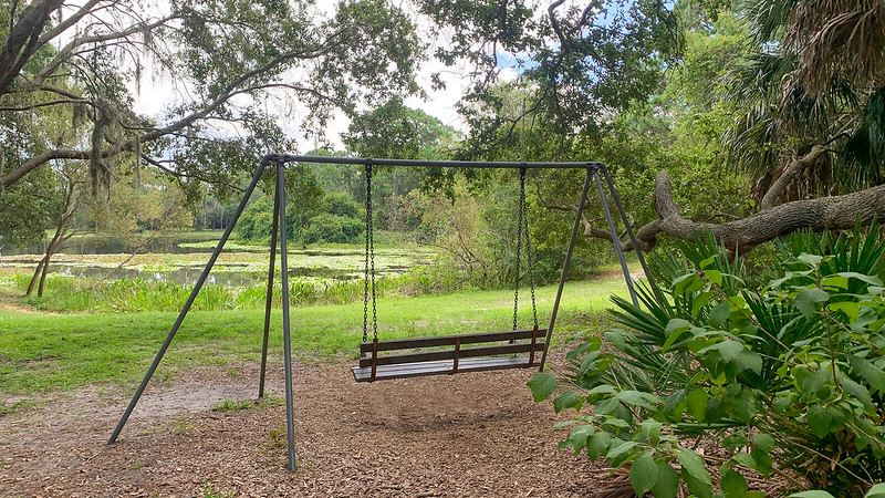 Swinging bench overlooks pond