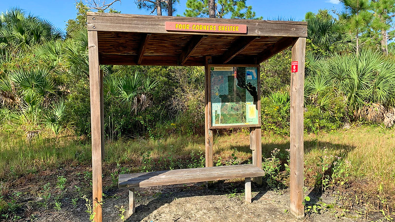 Shelter with bench and map