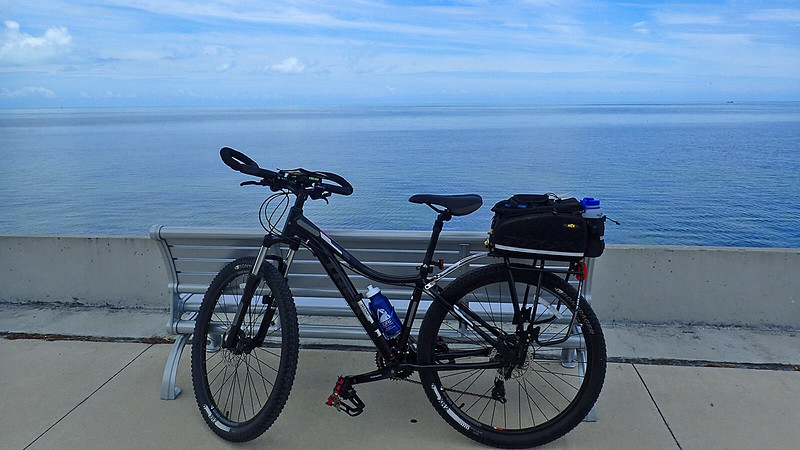 Bike on seawall with ocean beyond
