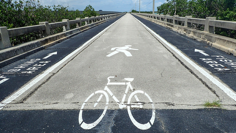 Bike lane symbol down middle of old bridge
