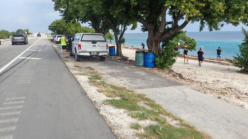Trucks and cars parked on bike path