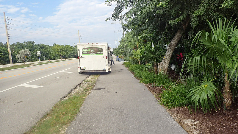 Truck partly parked on bike path