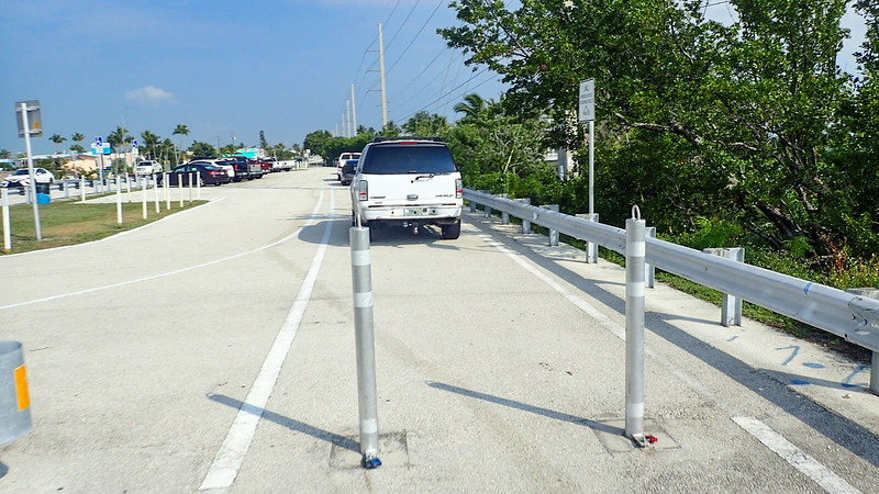 Cars parked on bike path
