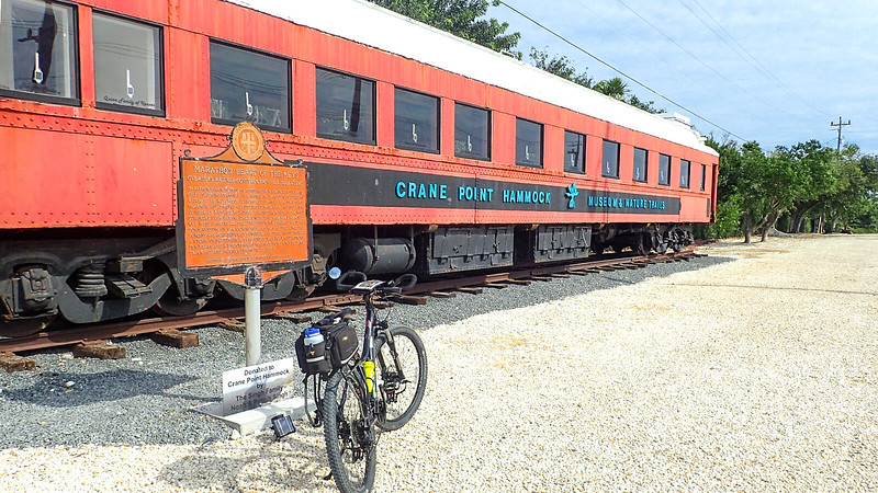 Bike in front of historic marker and railroad car