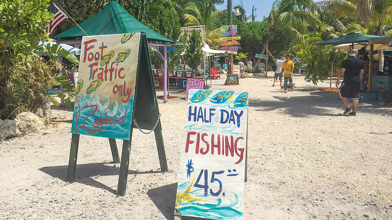 Colorful hand painted signs in tropical setting