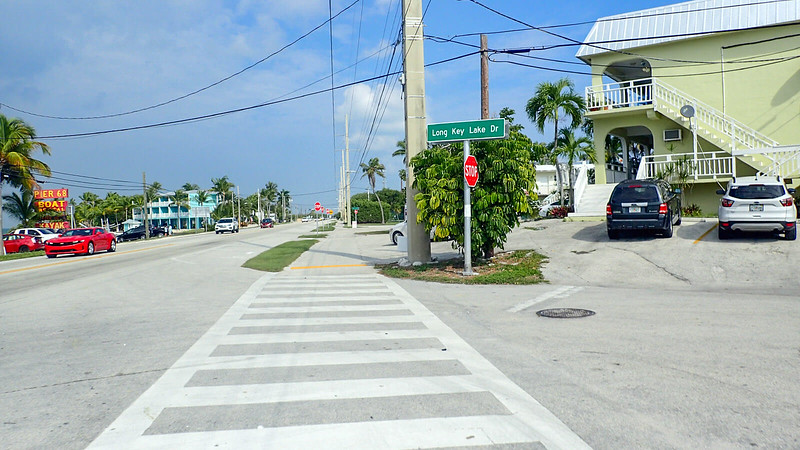 Crosswalk with buildings along bike path