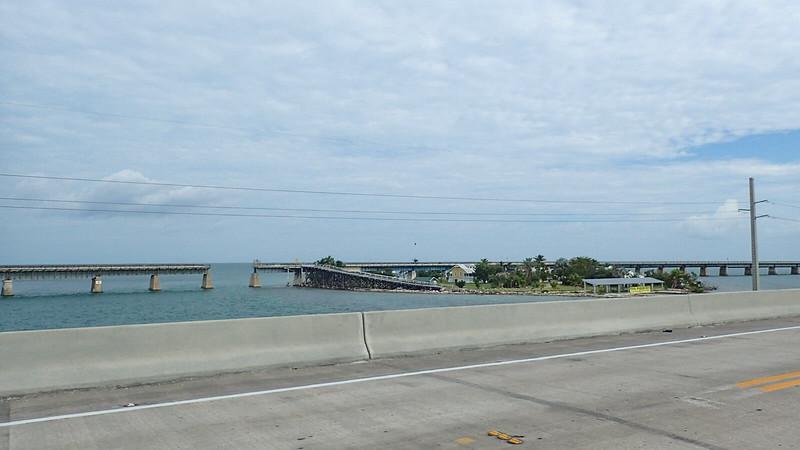 View of island along old bridge adjoining highway bridge