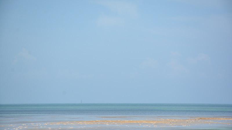 Shallow flats in ocean to horizon
